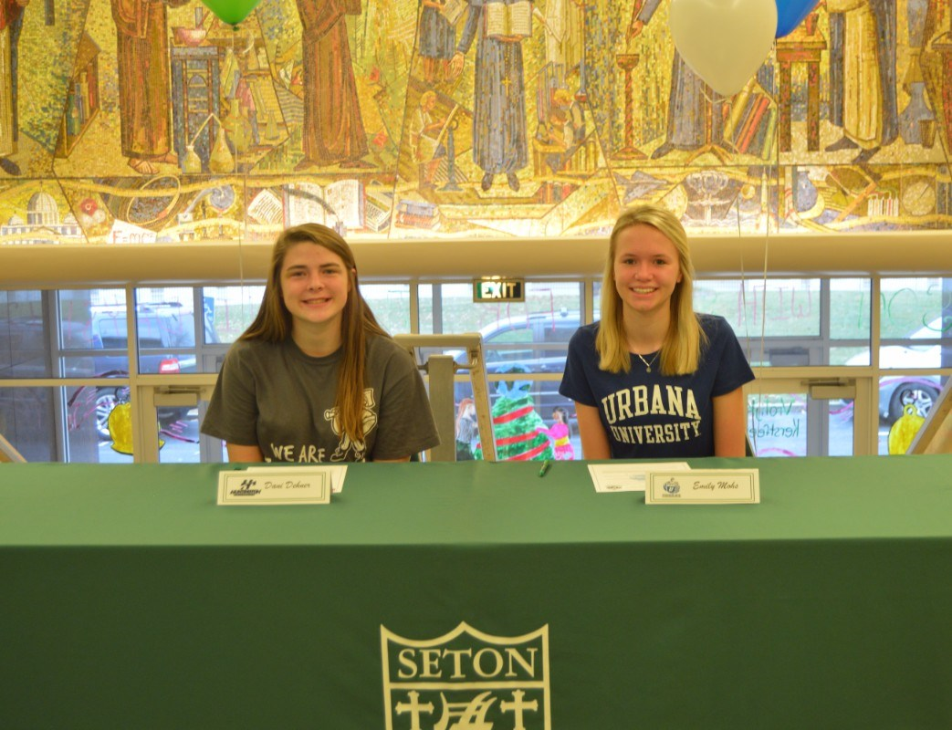 Emily Mohs and Dani Dehner sign National Letters of Intent.